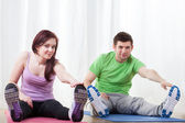 Woman and man stretching — Stock Photo