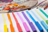 Art materials and colored lines — Stock Photo