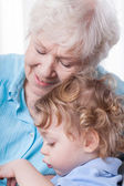 Grandma and her grandchild — Stock Photo