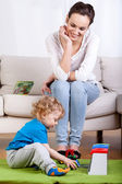 Mother and playing child — Stock Photo