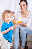 Mother and son during eating meal — Stock Photo
