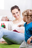 Mother and children during free time — Stock Photo