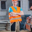 Builder standing at building area — Stock Photo #47496215
