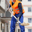 Builder working with a spade — Stock Photo #47496717