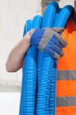 Builder with pipes — Stock Photo