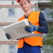 Builder with a brick — Stock Photo #47535307