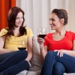 Female friends drinking wine — Stock Photo