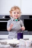 Cute little boy preparing muffins — Stock Photo
