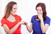 Woman showing engagement ring to her friend — Stock Photo