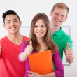 Happy students showing ok sign — Stock Photo
