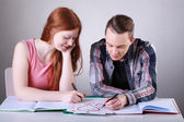Teenage couple drawing hearts instead of learning — Stok fotoğraf