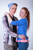 Smiling teenage couple hugging — Stok fotoğraf