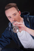 Portrait of a teenage boy drinking alcohol — Stock Photo