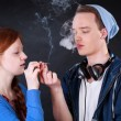 Teenagers smoking marijuana joint — Stock Photo #47924969