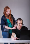 Boy ignoring girlfriend while playing computer games — Photo