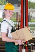 Warehouse worker holding box — Stock Photo