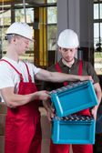 Production workers in protective workwear — Stock Photo