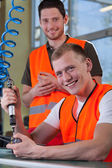 Portrait of a smiling collaborators from factory — Stock Photo