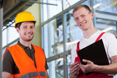 Factory workers and the project manager — Stock Photo