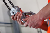 Close-up of male hands and lifting hook — Foto Stock