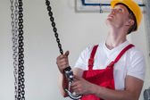 Man using lifting hook at work — Foto Stock