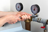 Man hands repairing pressure gauge — Stock Photo