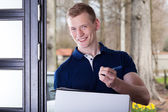 Man accepting a package — Stock Photo