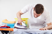 Man ironing clothes — Stock Photo