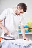 Man doing household chores — Stock Photo