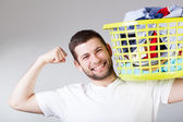 Happy man doingg laundry — Stock Photo