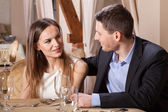 Couple talking in a restaurant — Stock Photo