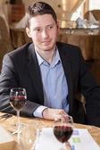 Man drinking wine in a restaurant — Stock Photo
