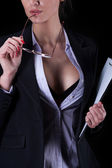 Businesswoman with unbuttoned shirt — Stock Photo