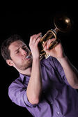 Man playing a trumpet — Stock Photo