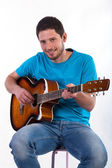 Man playing on acoustic guitar — Stock Photo