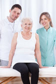 Lady with physiotherapists — Stockfoto