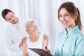 Woman with doctors — Stock Photo