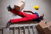 Storekeeper lying on floor — Stock Photo