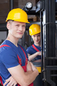Storekeepers near forklift — Stock Photo