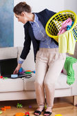 Businesswoman doing housework — Stock Photo