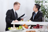 Diverse men during lunch time — Stock Photo