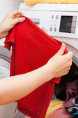 Housekeeper doing laundry — Stock Photo