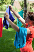 Housewife hanging  laundry — Stock Photo