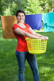 Woman with laundry — Stock Photo