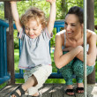 Boy swinging on monkey bars — Stock Photo #48581889