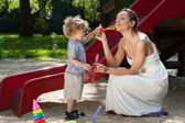 Mom and boy making bubbles — Stock Photo