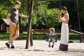 Family on playground — Stockfoto