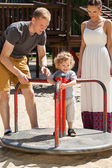 Boy on merry-go-round — Stock Photo