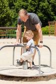 Son  on merry-go-round — Stock Photo