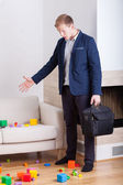 Businessman coming back home — Stock Photo
